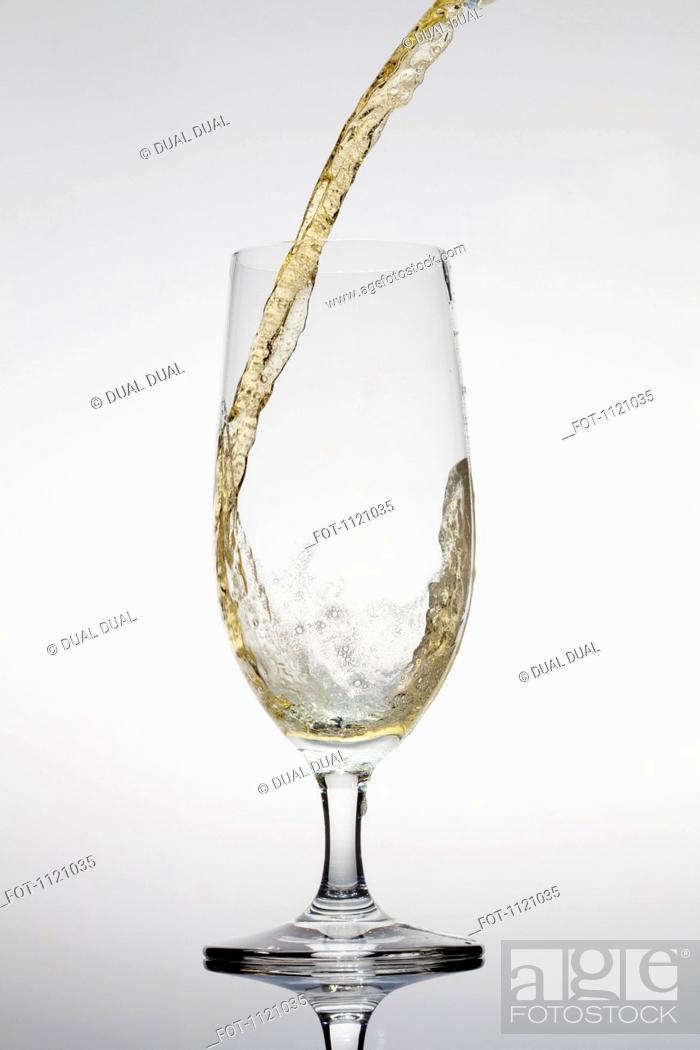 Stock Photo: Beer being poured into a glass.