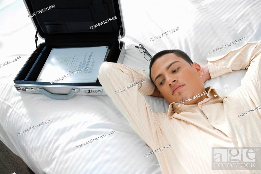 Stock Photo: Businessman lying on the bed.