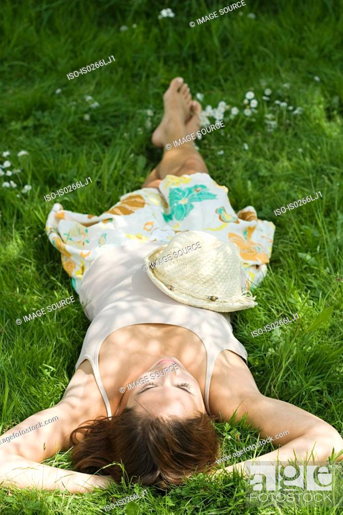 Stock Photo: Woman sleeping on grass.