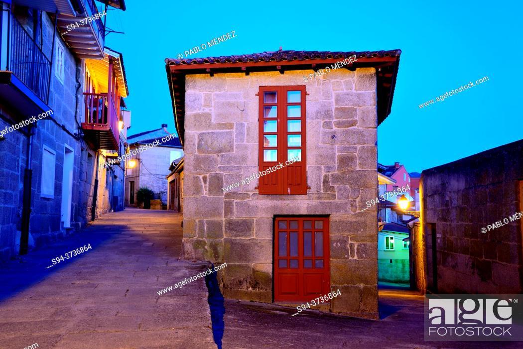 Stock Photo: Building between streets in Allariz, Orense, Spain.