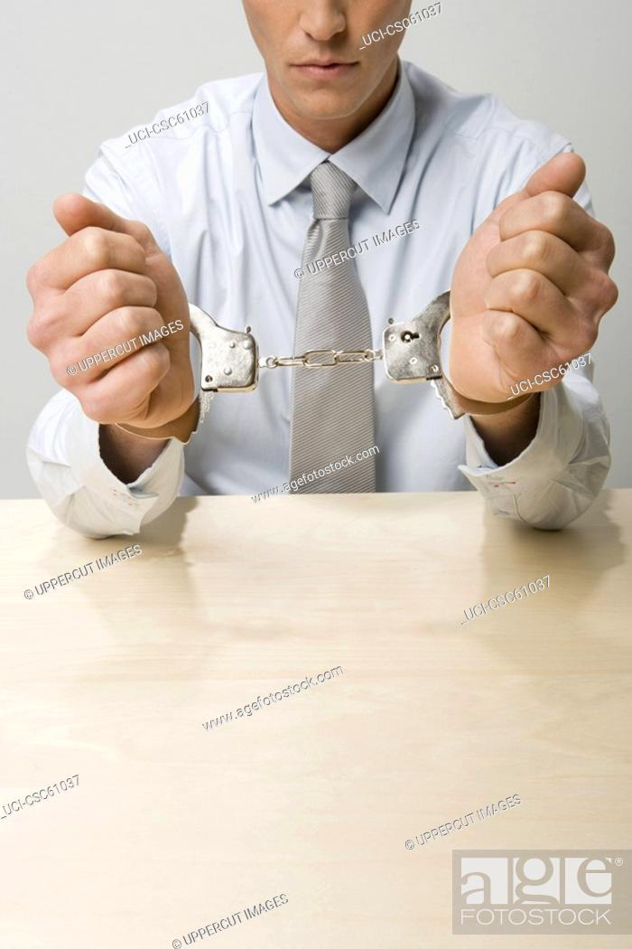 Stock Photo: Close up of businessman in handcuffs.