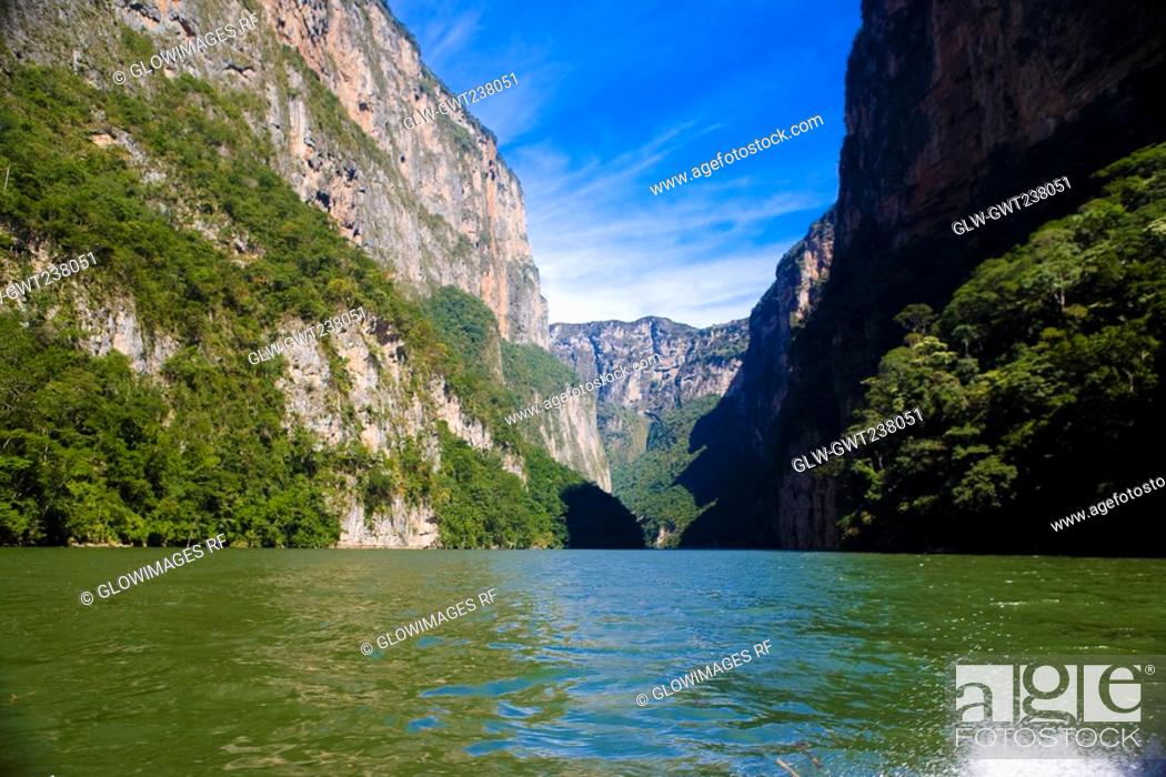 Stock Photo: Panoramic view of a lake with a mountain range in the background, Sumidero Canyon, Chiapas, Mexico.