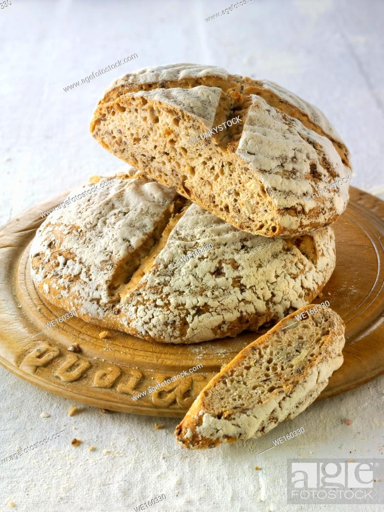 Stock Photo: Hand made artisan sour dough wholemeal seed bread made with white, malted and rye flour.