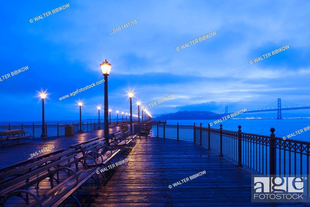 Stock Photo: USA, California, San Francisco, Embarcadero, harbor view with Bay Bridge from Pier 7, Broadway Pier, dawn.