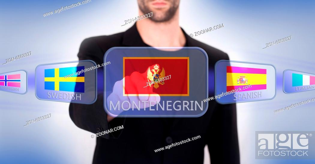 Imagen: Hand pushing on a touch screen interface, choosing language or country, Montenegro.