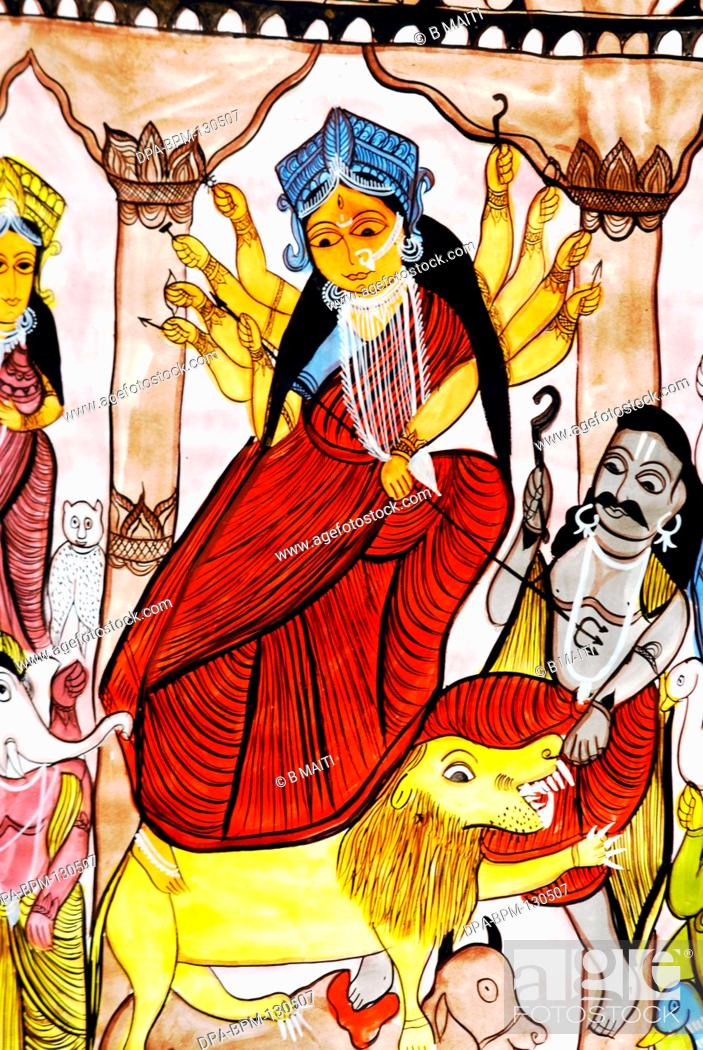 Painting of goddess Kali killing demon , India, Stock Photo