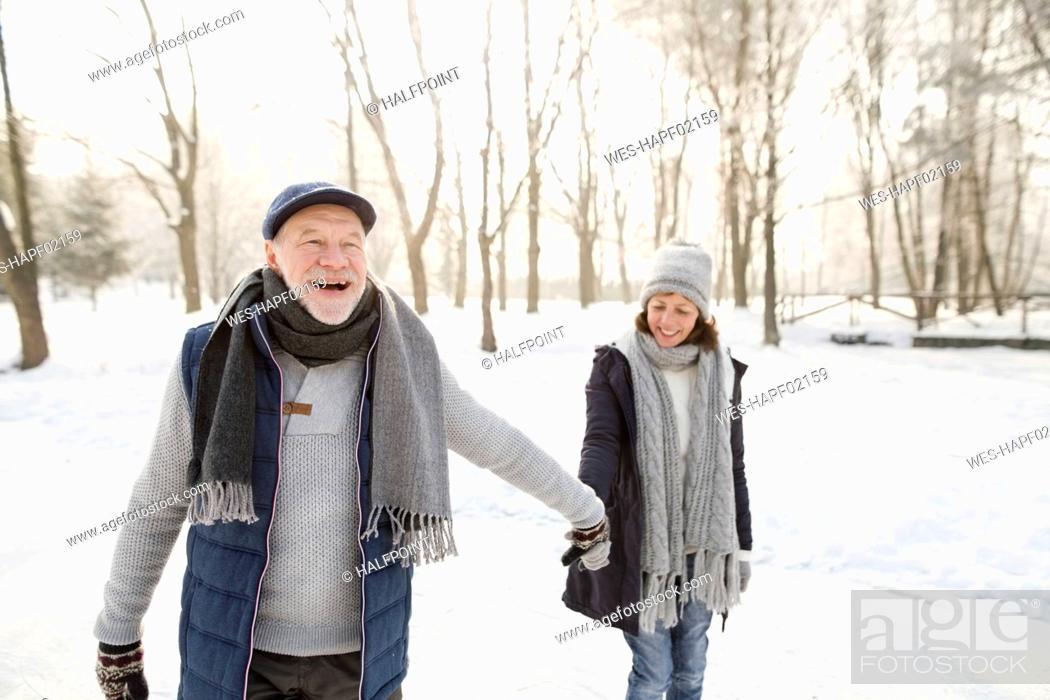Stock Photo: Happy senior couple ice skating.