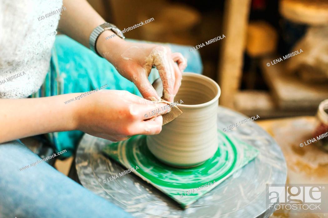Photo de stock: Artist working in pottery studio.
