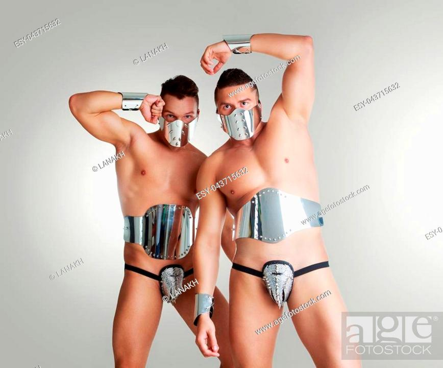 Stock Photo: striptease dancers wearing sparkling silver costumes in the studio isolated against white background.