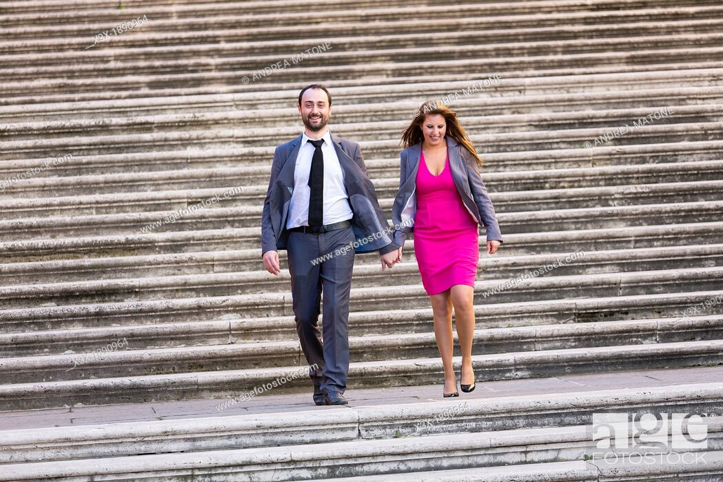 Stock Photo: Engagement couple walking on stairs in Rome Italy.