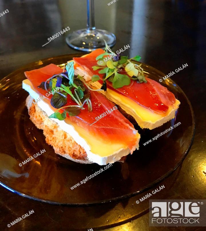 Stock Photo: Spanish tapa: Iberian ham with cheese on toast. Spain.