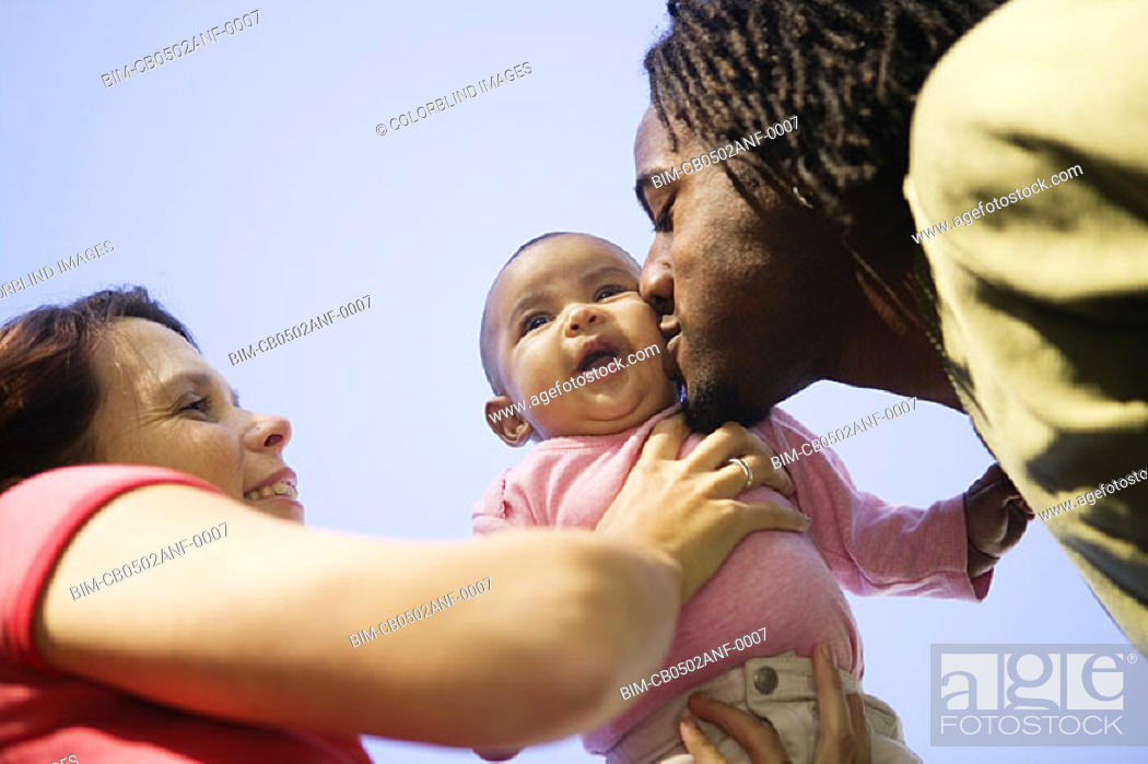 Stock Photo: Low angle view of couple with baby.