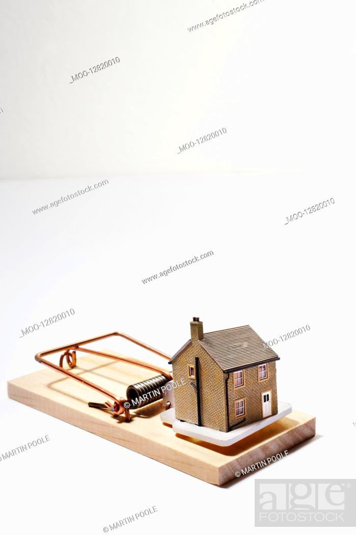 Stock Photo: Model house as bait on mousetrap.
