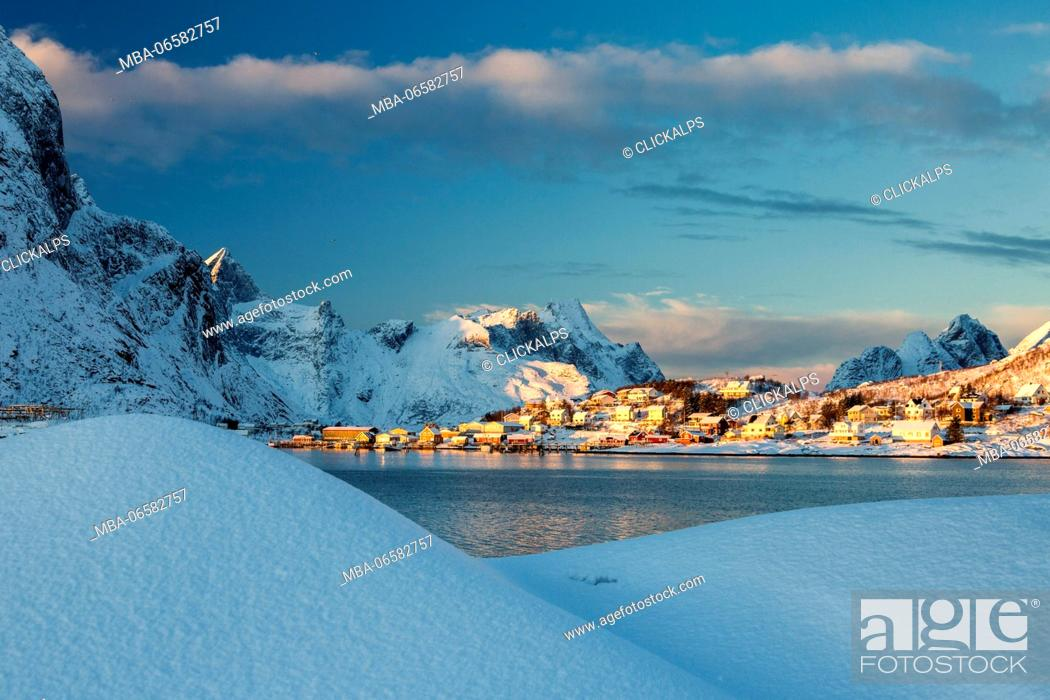 Stock Photo: The blue color of dusk on the fishing village and the snowy peaks Kvalvika Andøya Reine Nordland Lofoten Islands Norway Europe.