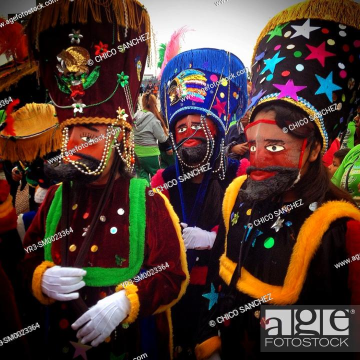 Stock Photo: Chinelos dance during the annual pilgrimage to the Our Lady of Guadalupe basilica in Mexico City, Mexico.