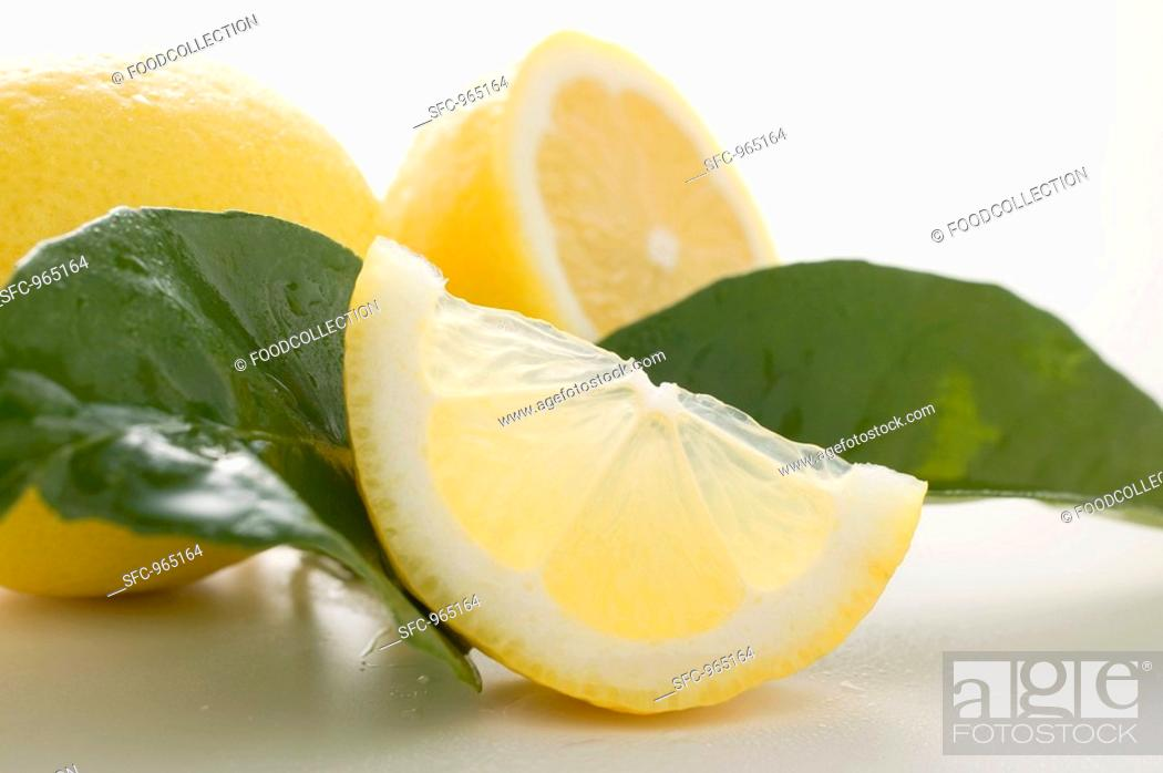 Stock Photo: Lemons with leaves.
