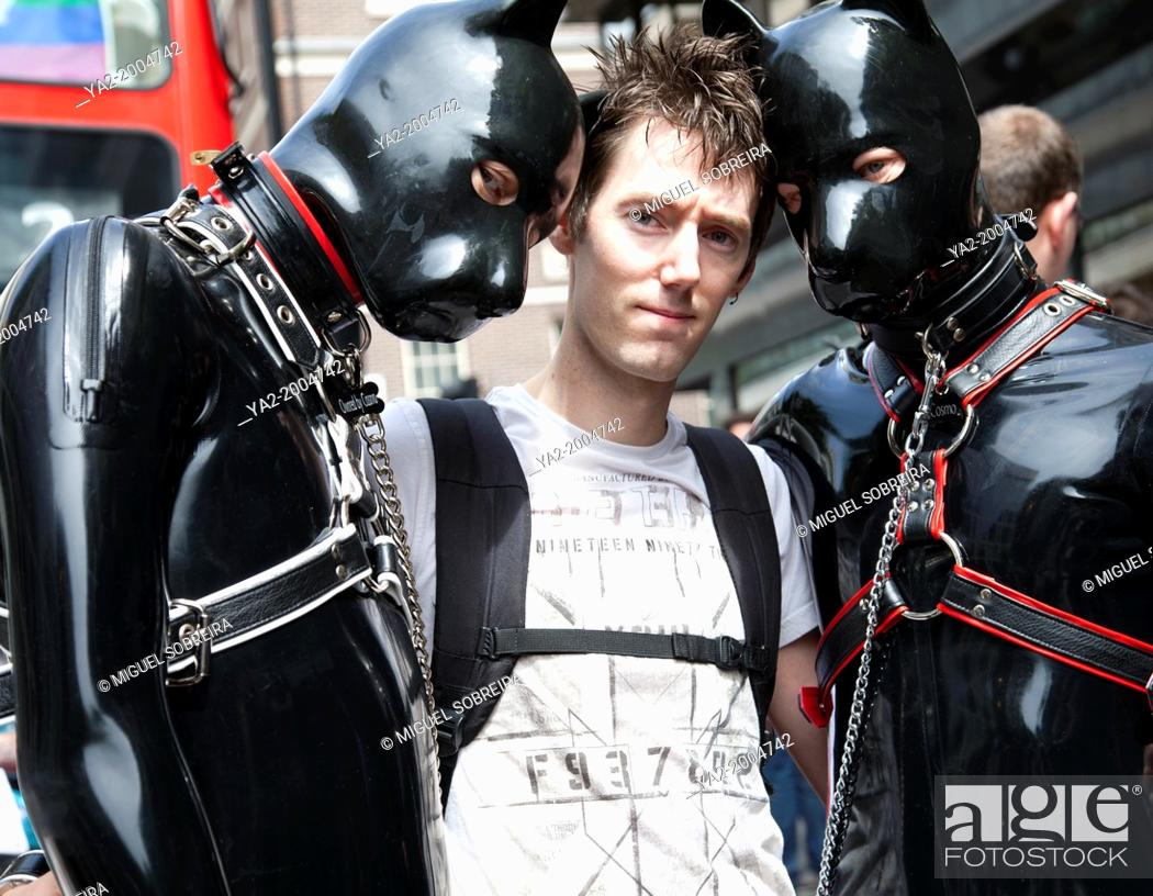 Stock Photo: London Gay Pride - Characters dressed in Slave Dog Gimp on the March.