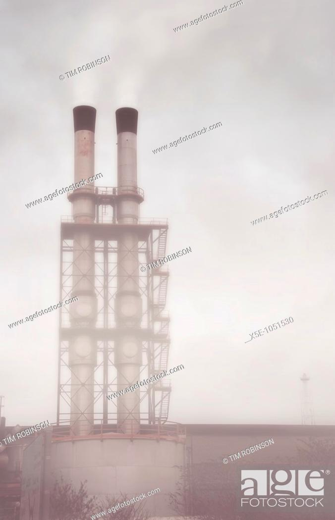 Stock Photo: Two industrial chimneys issueing smoke.