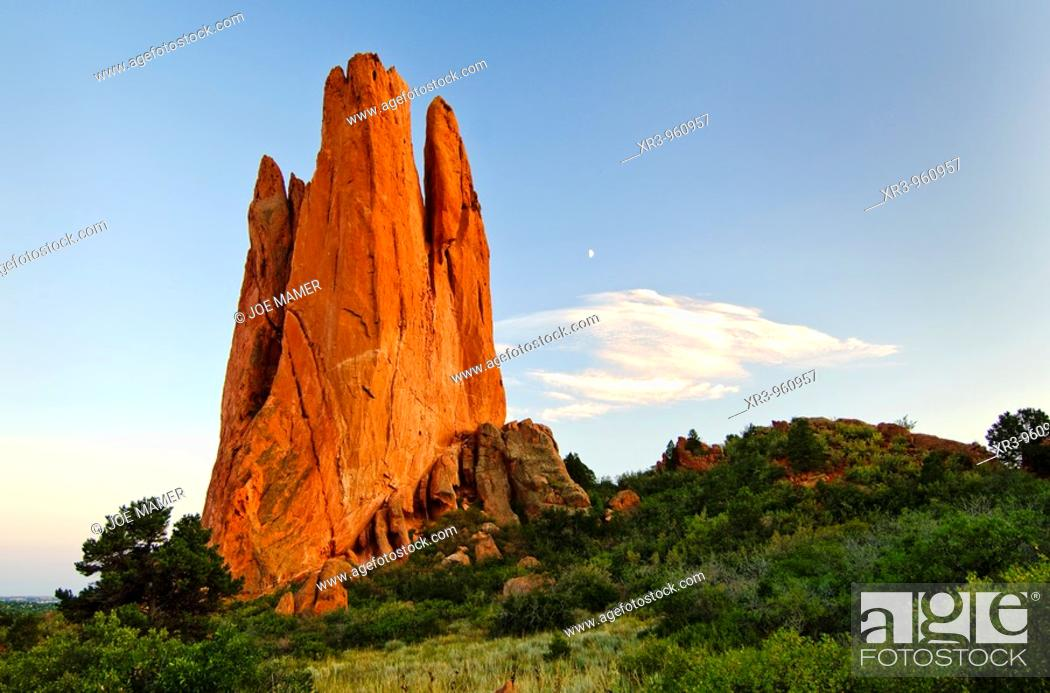 Stock Photo: Moonrise at the Tower of Babel rock formation at The Garden of the Gods in Colorado Springs, Colorado  The Garden of the Gods was originally a gift to the.