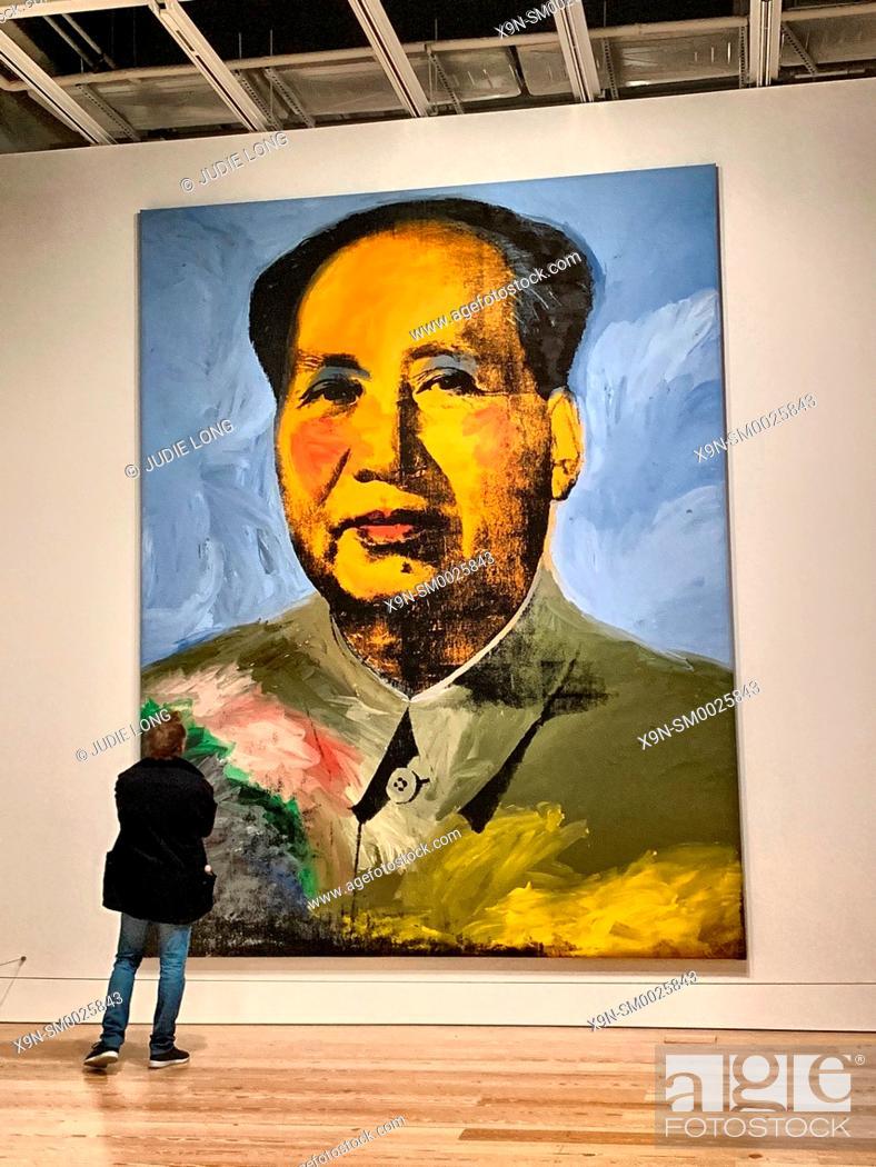 Stock Photo: Man Admiring Andy Warhol's Chairman Mao Painting. New York, NY, USA.