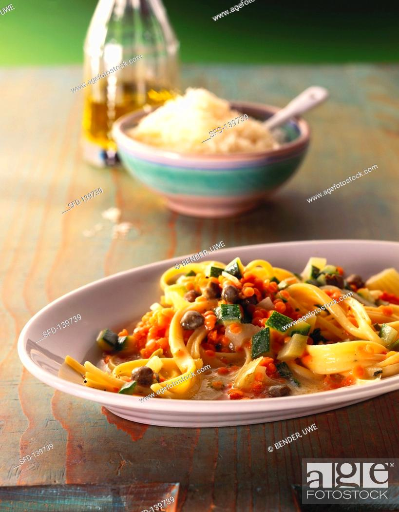 Stock Photo: Tagliatelle with red lentils, vegetables and capers.