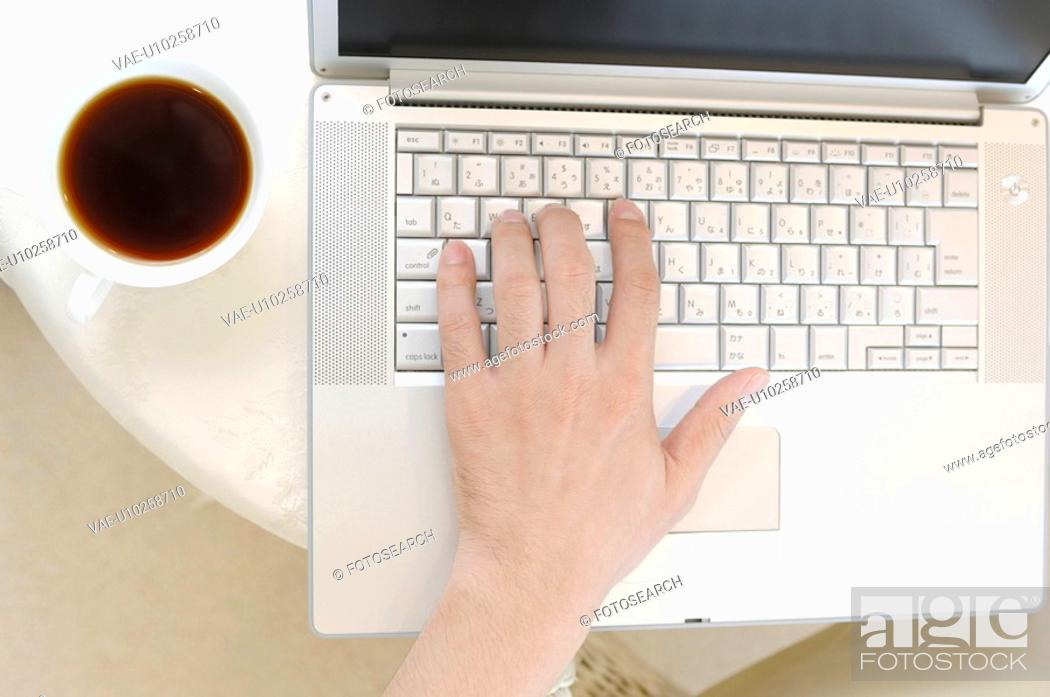 Stock Photo: Hand which strikes a key board.