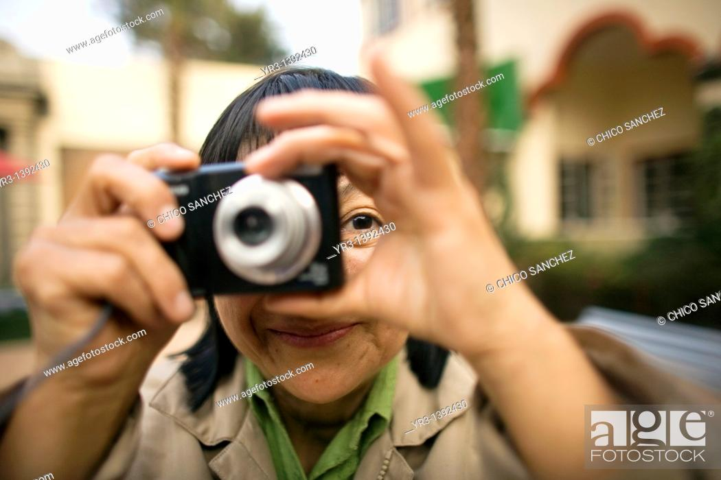 Stock Photo: A blind student takes pictures.