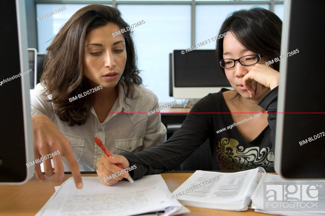 Stock Photo: College students studying together.