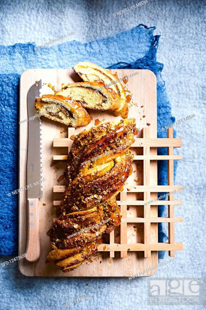 Stock Photo: Macadamia and oatmeal bread plait.