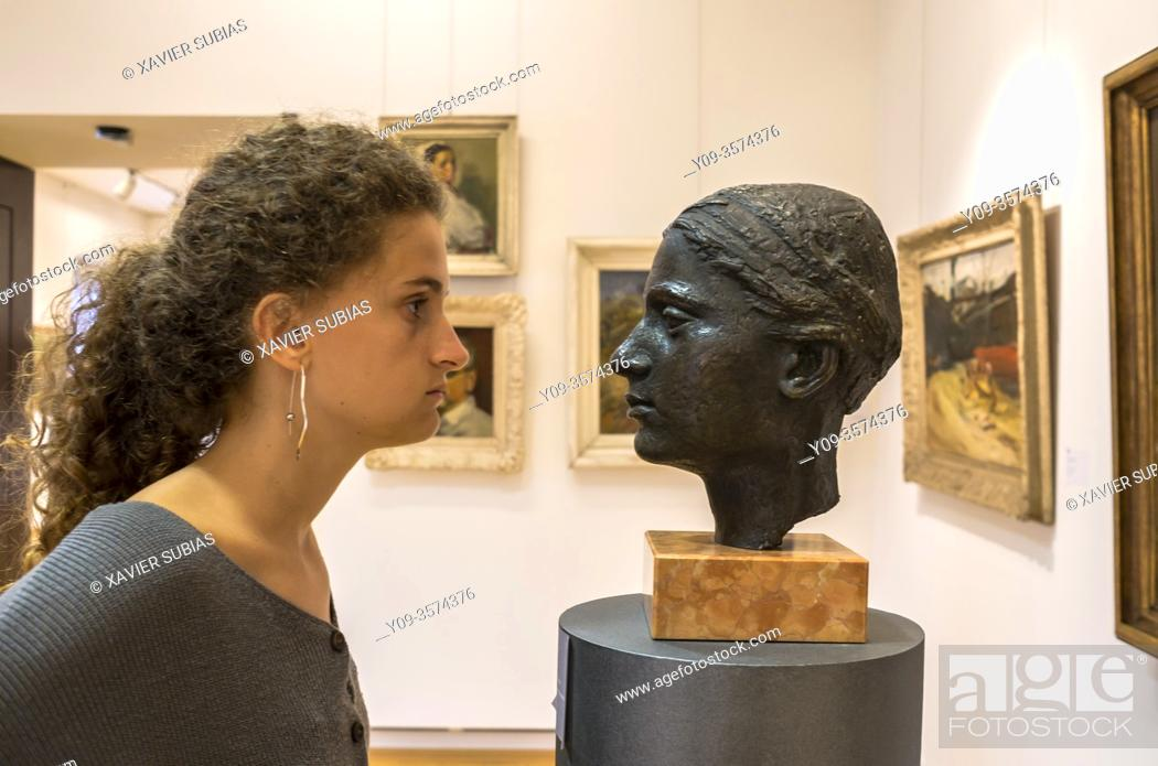 Stock Photo: Girl in front of a bust, Modern Gallery, Zagreb, Croatia.