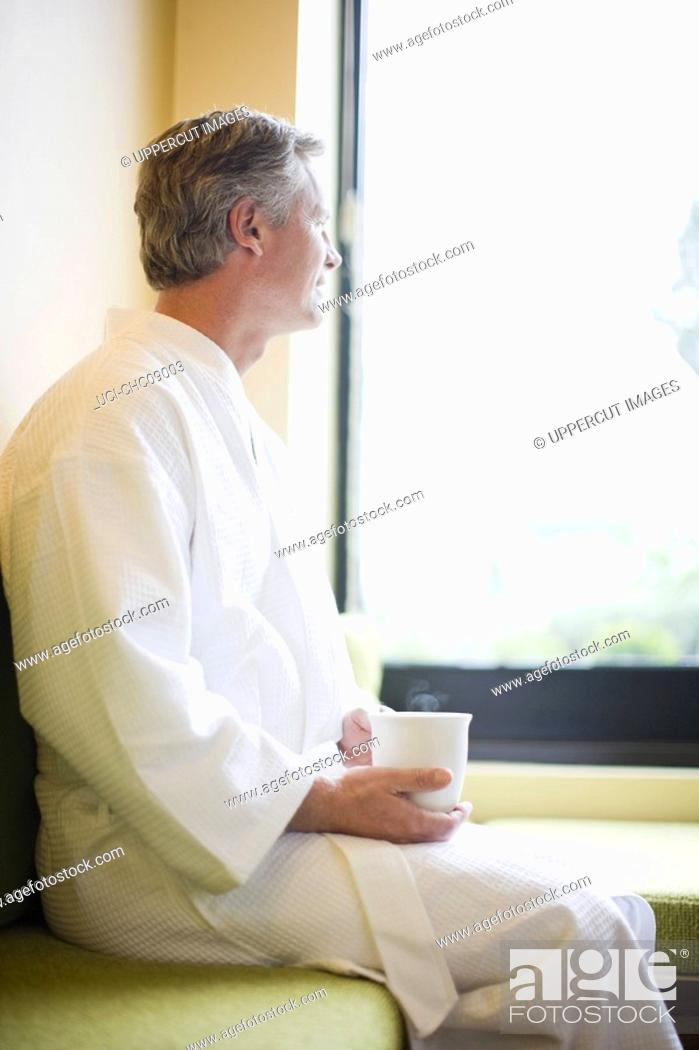 Stock Photo: Man holding cup of tea.