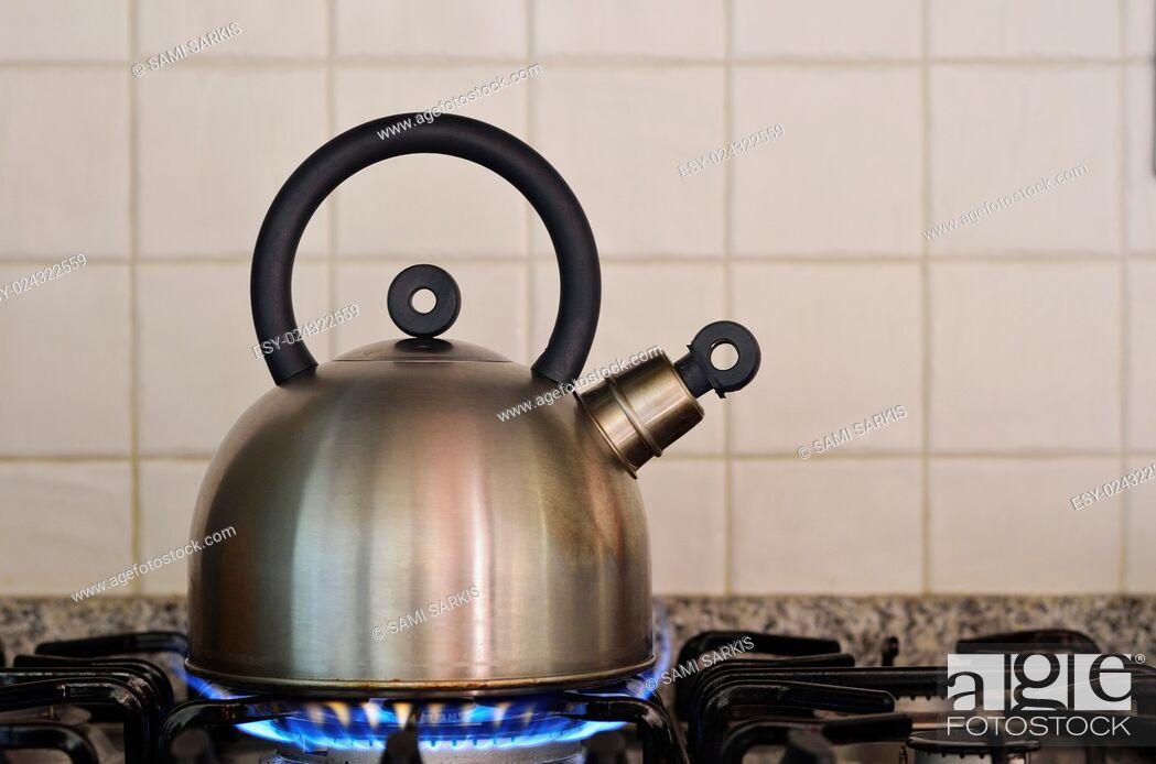 Stock Photo: Teapot on gas stove burner.
