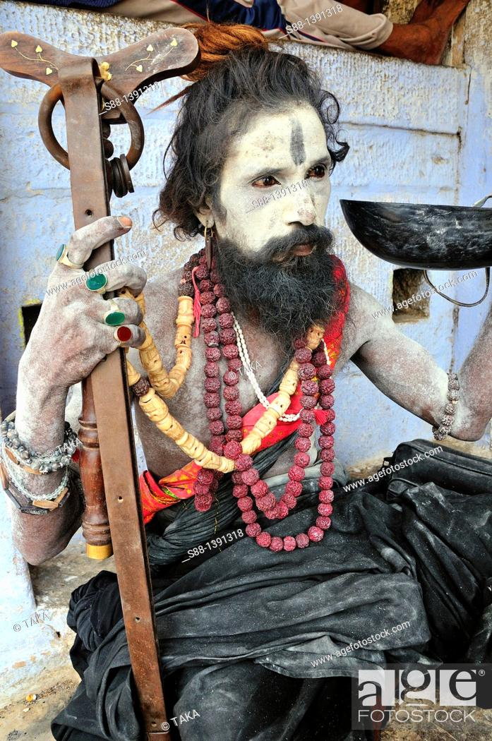 Stock Photo: Sadhu at the ghat by the Ganges River.