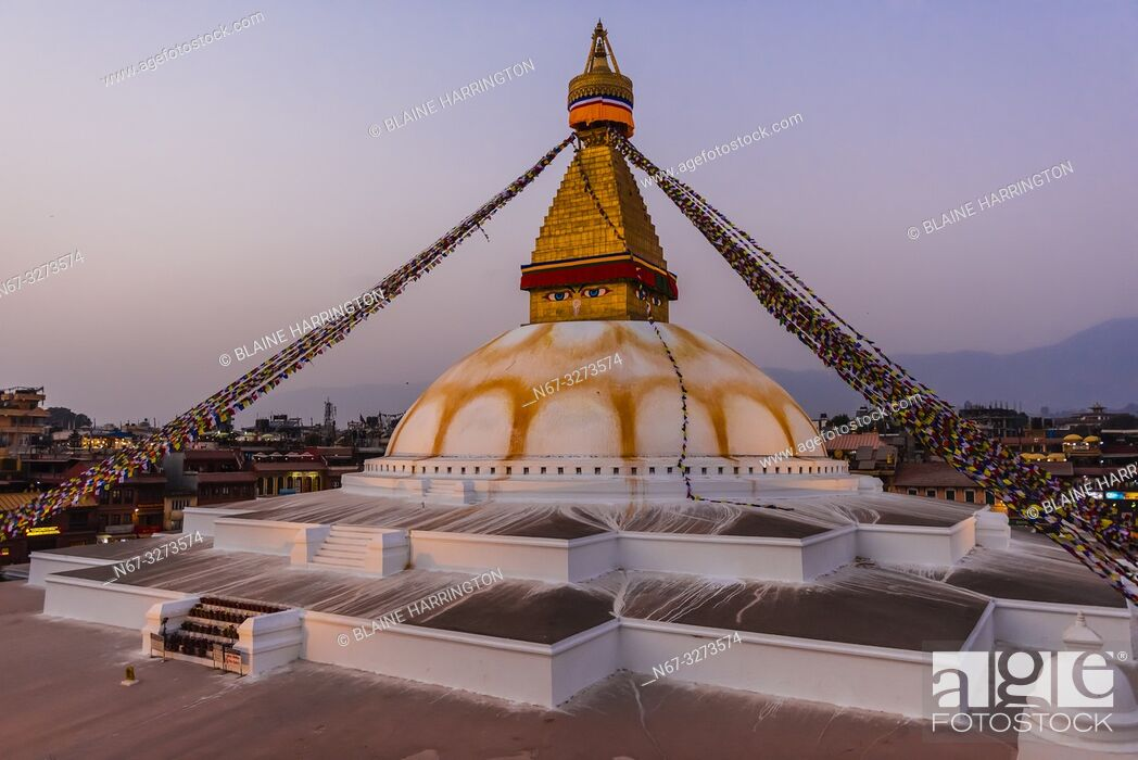 Stock Photo: Prayer flags ring the massive stupa of the Boudhanath Temple. It is the largest stupa in Nepal and the holiest Tibetan Buddhist temple outside Tibet.