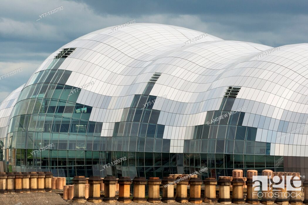 Stock Photo: The Sage building in Newcastle up Tyne seen above old chimney tops  England.