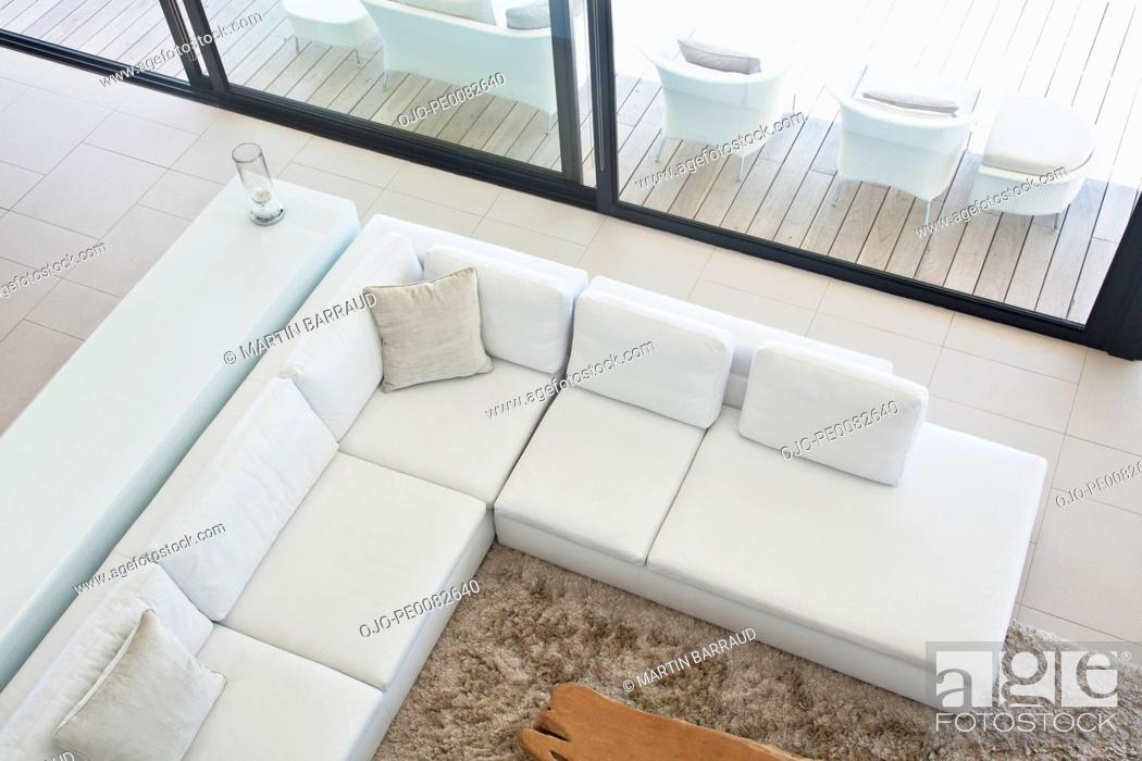 Stock Photo: High angle view of sectional sofa in modern living room.