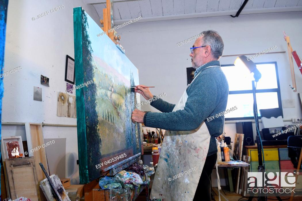 Stock Photo: Painter artist painting a picture in the studio.