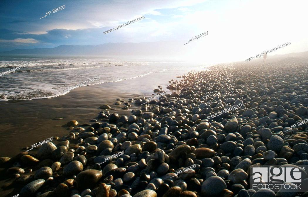 Stock Photo: Figure in mist    Bluecliffs Beach Waitutu Southland New Zealand.
