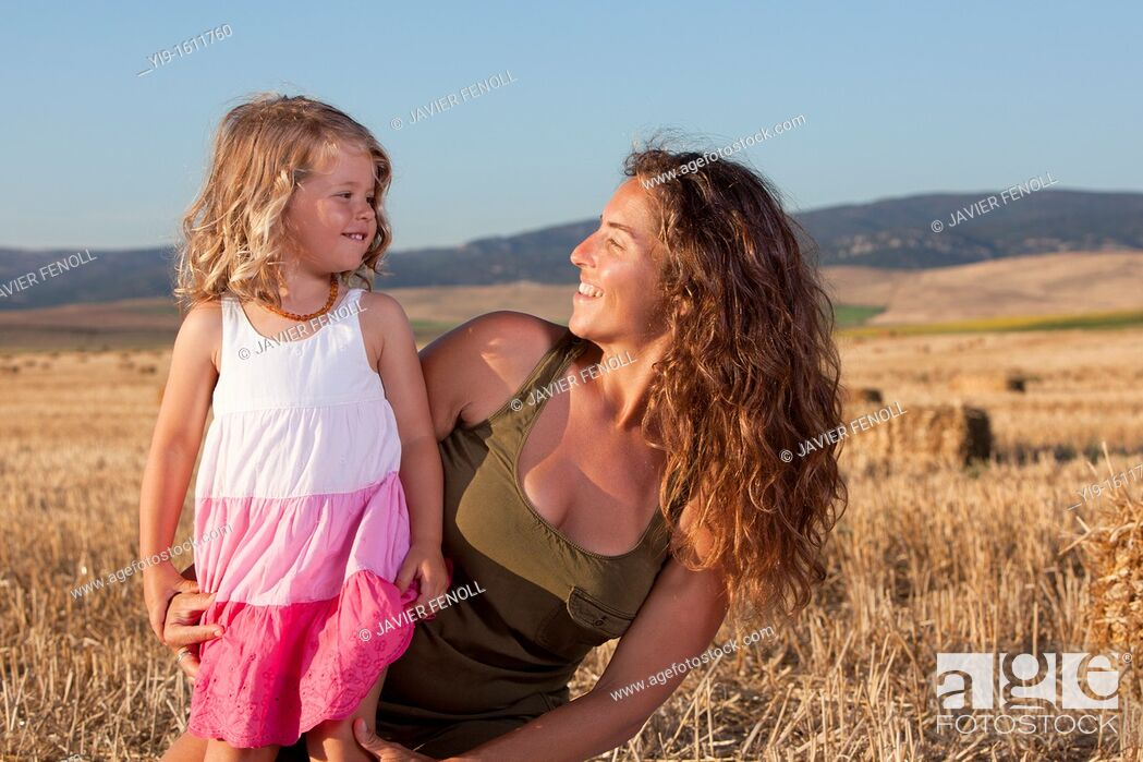 Stock Photo: mother and daughter in the field.