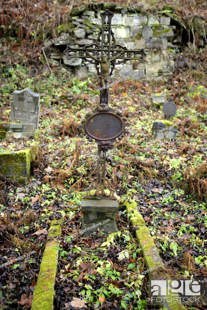 Stock Photo: Cross on a grave, abandoned cemetery, Joachimsthal, West Bohemia, Czech Republic, Europe.