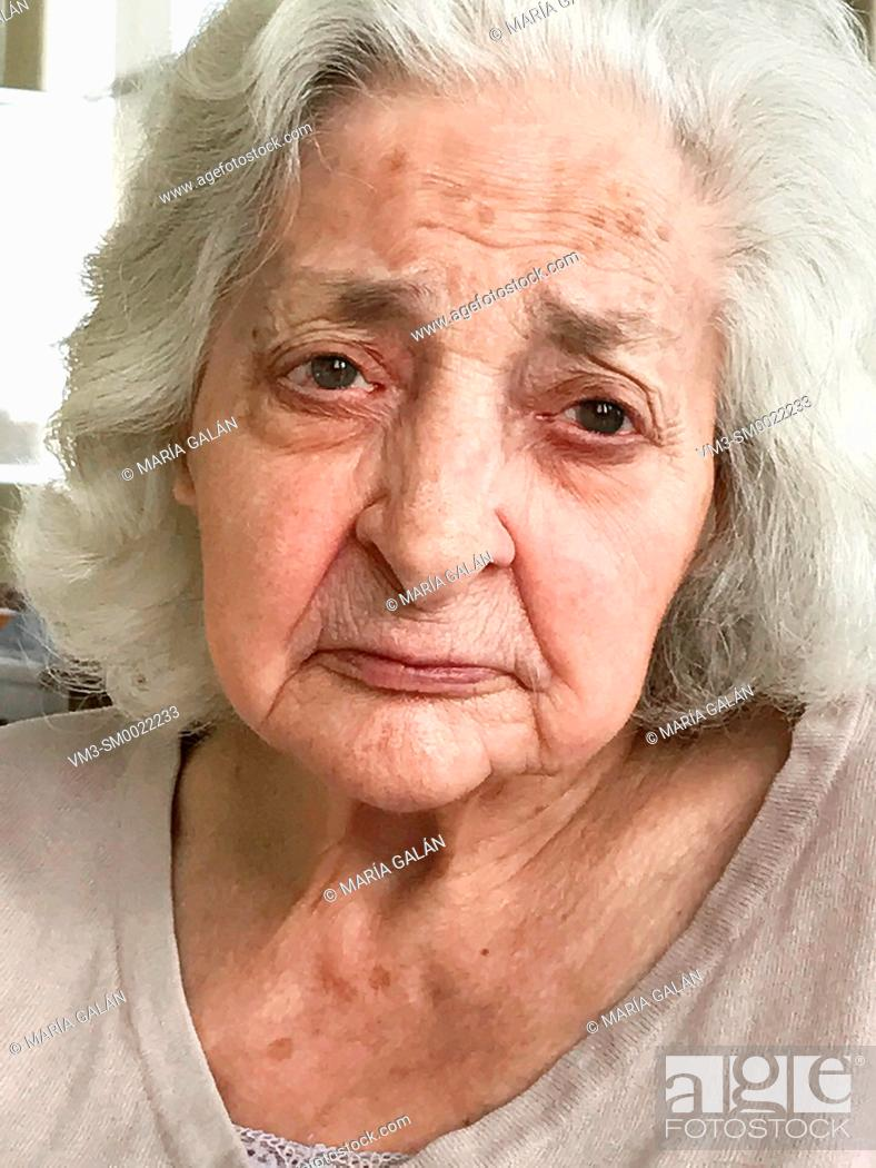 Stock Photo: Portrait of old lady. Close view.