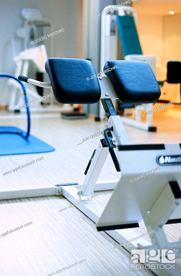 Stock Photo: Body-building machine, athletic implement in a fitness room of a gym, fitness center.