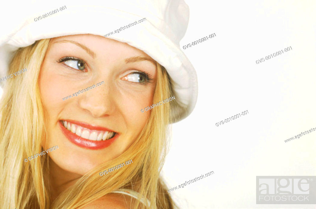 Stock Photo: Portrait of a Young Woman With Blonde Hair Wearing a White Hat.