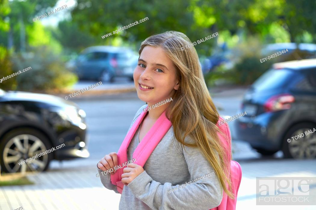 Stock Photo: Blond kid student girl with backpack in the city back to school.