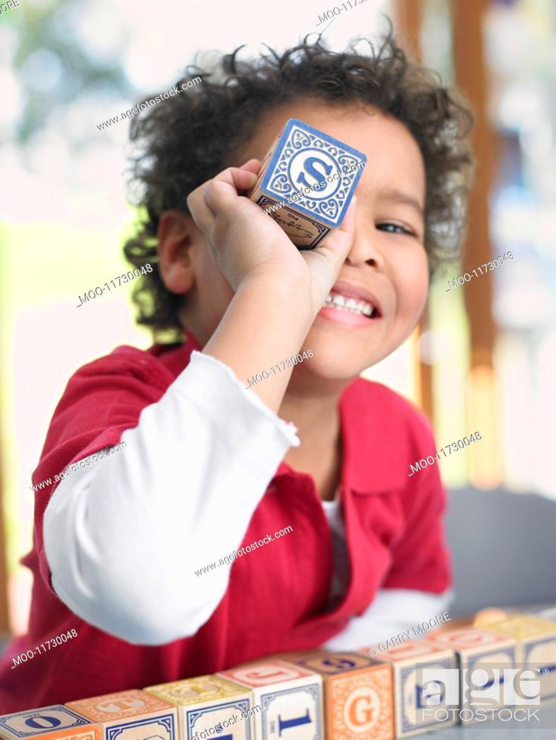 Stock Photo: Boy playing with alphabet blocks portrait.