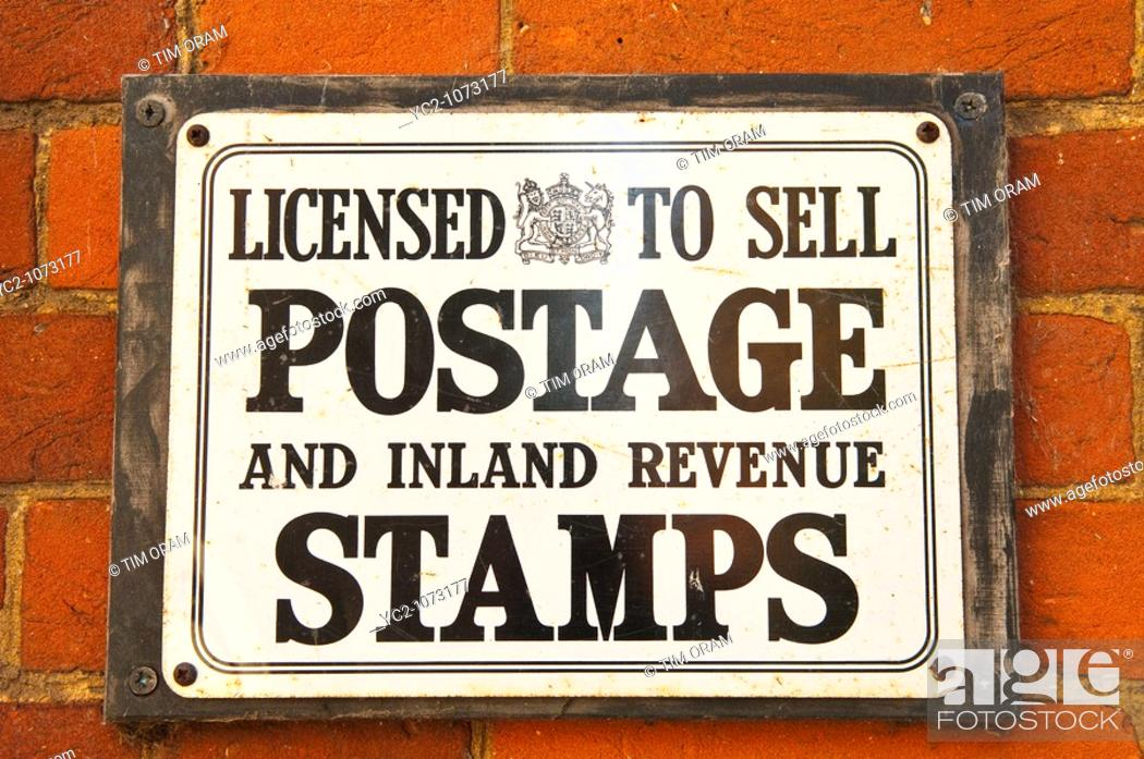An old sign from a shop store selling stamps at Gressenhall