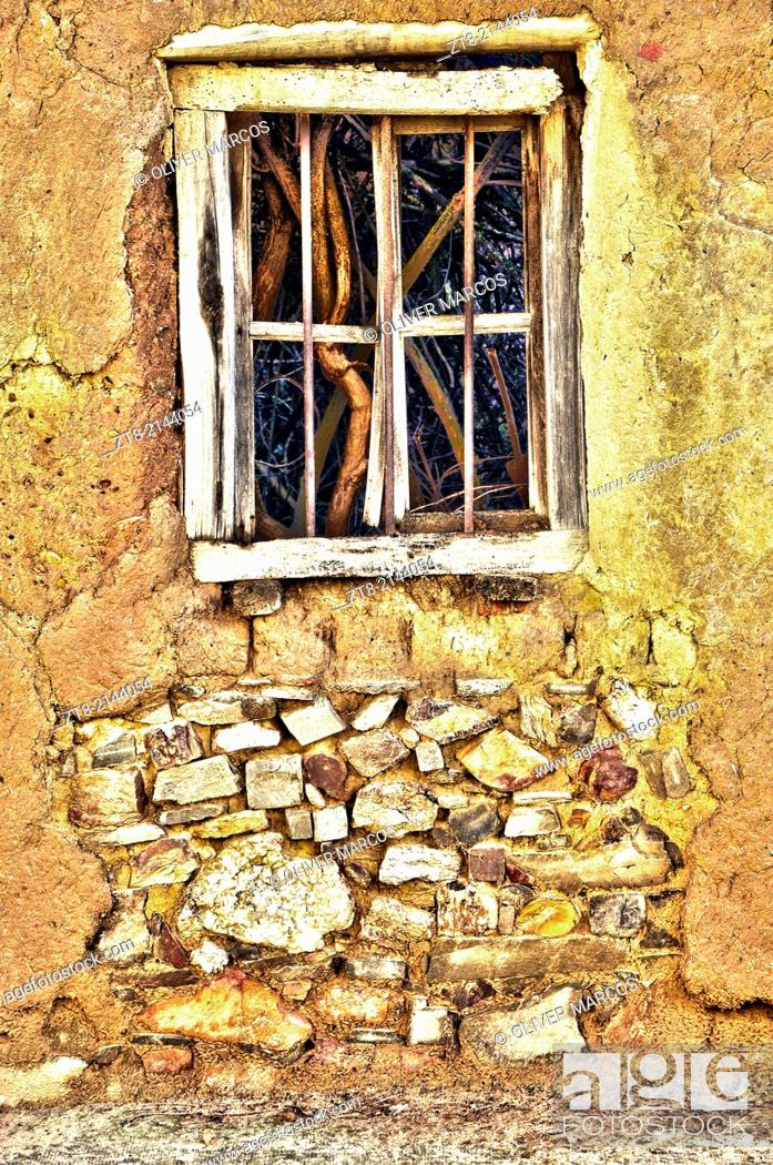 """Imagen: In Leon, in the Northwest of Spain, there are many abandoned villages, you can still see houses built as before, with stone, wood, brick """"""""adobe"""""""", clay tiles."""