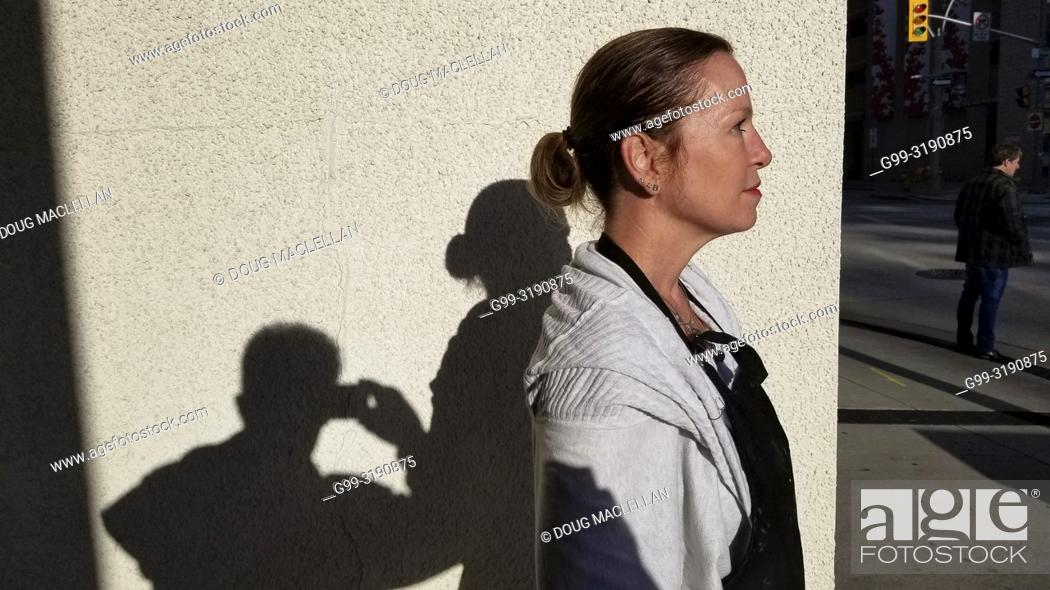 Stock Photo: A woman poses in profile in the late afternoon, Windsor, Canada.