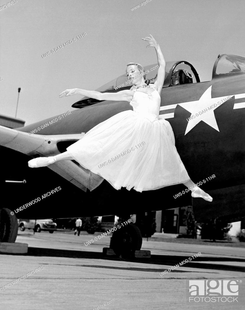 United States: c  1946 A ballerina does a graceful leap with