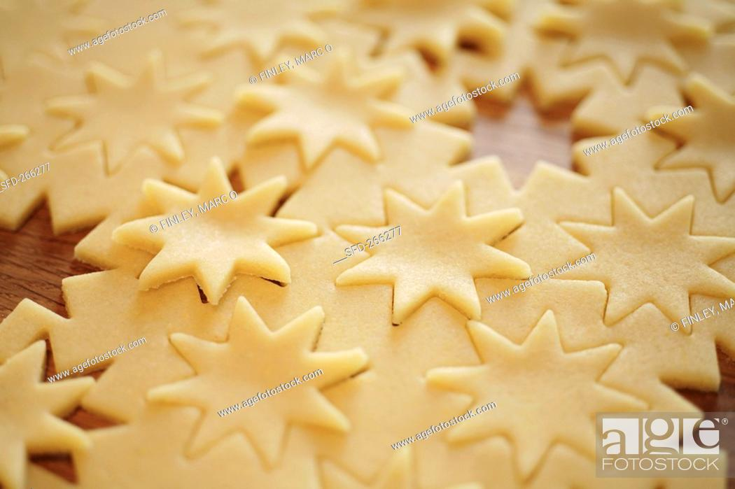Stock Photo: Raw pastry with cut-out stars.